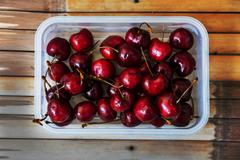 Fresh cherries on bamboo table by top view - stock photo