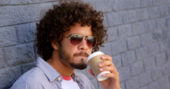 Young man having coffee from disposable cup Stock Footage