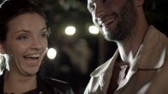 Young romantic man woman couple in love smile, laugh using smartphone - stock footage