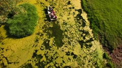 Aerial shot grandpa with his grand kids in row boat - stock footage