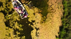 Grandfather with grand kids in row boat - stock footage