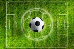 Soccer ball on green grass stadium with white layout - stock photo
