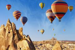 Hot air ballooning near Uchisar castle, Cappadocia Stock Photos