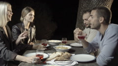 Group of four happy men and women friends smile and enjoy aperitif Stock Footage
