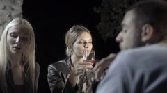 Two women friends talk and smile while enjoying aperitif Stock Footage