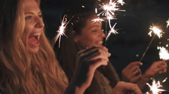 Beach sparkler fun Stock Footage
