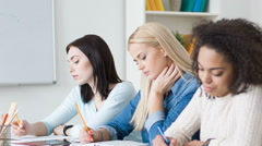 Pleasant students studying at the table - stock footage