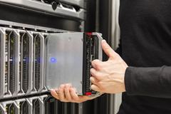 IT consultant install blade server in large datacenter Stock Photos