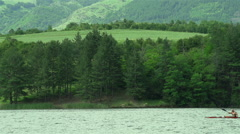Kayaker sail in the lake in slow motion Stock Footage