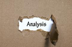 The word analysis appearing behind torn paper Stock Photos