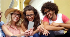 Friends looking at smartphone Stock Footage