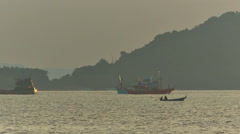 Summer sunrise working fisher boats ride panorama hd phuket thailand Stock Footage