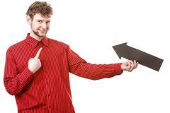Adult man holding arrow. Stock Photos