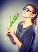 Charming woman smelling flower feel peace. - stock photo