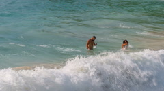Summer freedom beach couple swimming in waves hd phuket thailand Stock Footage