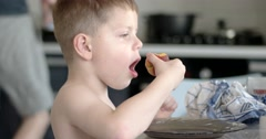 Child Eating Peach Indoor. Young 5-8 Year Old Boy Eating Nutritional Fruit Stock Footage