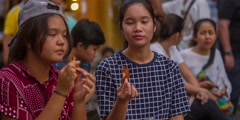 Young ladies eating on phuket town street market hd thailand Stock Footage