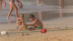 Summer day children on the beach playing with sand hd phuket thailand Stock Footage