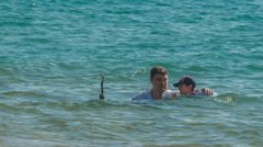 Summer day airport beach father and son swimming hd phuket thailand Stock Footage