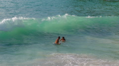 Freedom beach clean water couple swimming in waves hd phuket thailand Stock Footage