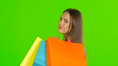 Woman holding shopping and money. Green screen. Close up Stock Footage
