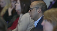 Attentive audience listening to speaker at a conference Stock Footage