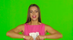 Woman is laughing and throwing money in air. Green screen. Close up Stock Footage