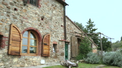 Panning on a window of beautiful rural farm house from outdoor in tuscany Stock Footage