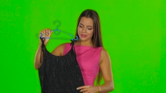 Girl had chosen a black dress. Green screen. Close up Stock Footage