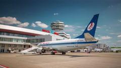 Summer day minsk international airport jet plain park 4k time lapse belarus Stock Footage