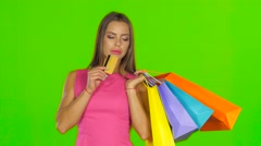 Woman with shopping bags and credit card. Green screen. Close up Stock Footage
