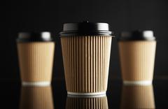 Brown luxury take away paper cups set black mirrored Stock Photos