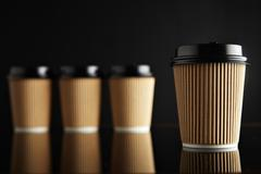 Brown luxury take away paper cups set black mirrored - stock photo