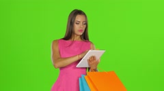 Woman does shopping with credit card and tablet. Green screen. Close up Stock Footage