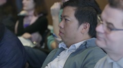 Man listening to a presentation at a corporate event Stock Footage