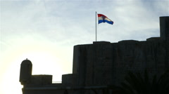CROATIAN FLAG FORTRESS WALL TOWN DUBROVNIK CROATIA Stock Footage