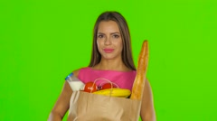 Woman holding bag with groceries food. Green screen. Close up Stock Footage