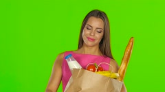 Girl enjoying the aroma of the products. Green screen. Close up Stock Footage