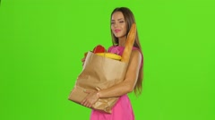 Woman bought food with gold card. Green screen Stock Footage