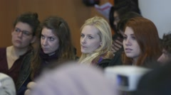 Four women listening to a conference talk and powerpoint presentation Stock Footage