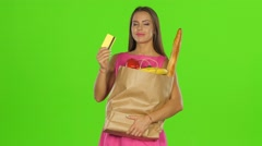 Girl pressed the card and package to himself and smiles. Green screen Stock Footage