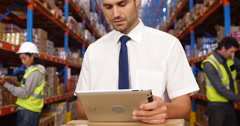 Warehouse workers working together Stock Footage