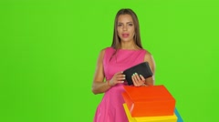 Woman with credit card and shopping bags. Green screen Stock Footage