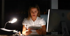 Businesswoman holding documents at night Stock Footage