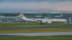 Etihad airbus 340 taxiing at early morning Stock Footage