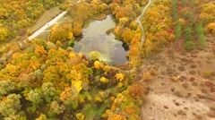 AERIAL VIEW. Flight Above Scenic Terrain At Fall Time Stock Footage