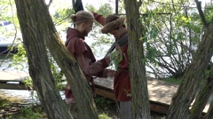 Dressing up for medieval reenactment - stock footage