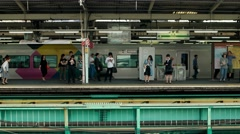 Tokyo - Nakano station platform with people waiting for train. 4K resolution Stock Footage