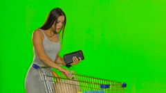 Woman on the shopping controls the funds in the wallet. Green screen Stock Footage