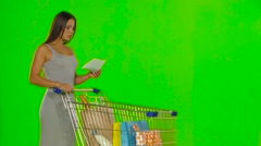 Woman checks the shopping list. Green screen Stock Footage
